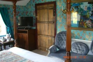 A television and/or entertainment center at Ash Farm Country House
