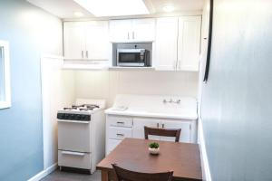 A kitchen or kitchenette at Ocean Echo Inn & Beach Cottages