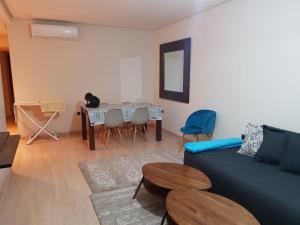 A seating area at Prestigia appartement opale