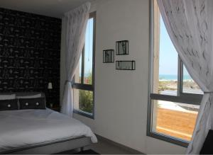 A bed or beds in a room at Adva Boutique Hotel