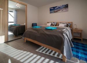 Postel nebo postele na pokoji v ubytování Astra Lipno