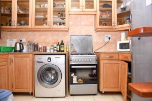 A kitchen or kitchenette at Corinya Serviced Apartments Limited