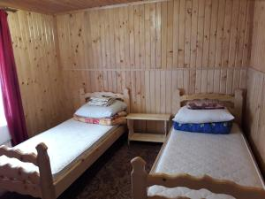 A bed or beds in a room at Гостинна хата