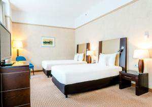 A bed or beds in a room at Hotel Polonia Palace