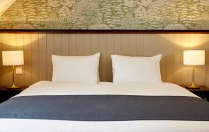 A bed or beds in a room at Ravensworth Arms Hotel by Greene King Inns