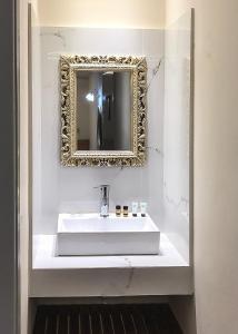 Ein Badezimmer in der Unterkunft Omiros