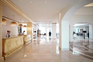 The lobby or reception area at Mitsis Laguna Resort & Spa