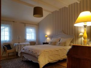 Un ou plusieurs lits dans un hébergement de l'établissement Chambres d'Hôtes Le Clos Du Verger