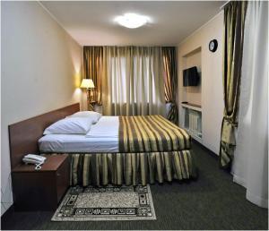 Кровать или кровати в номере Mini-hotel Astra