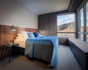 A bed or beds in a room at Fosshotel Glacier Lagoon