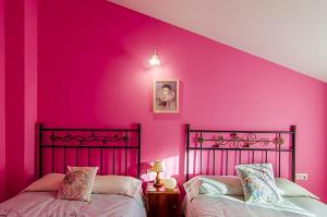 Cama o camas de una habitación en Casa Rural Las 6 Hermanas
