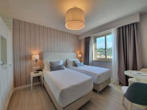 Кровать или кровати в номере Hotel Plaza
