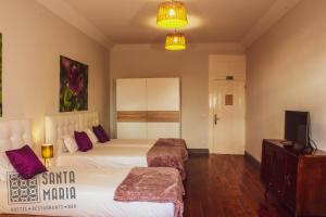 A bed or beds in a room at Santa Maria Hostel