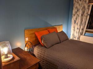 A bed or beds in a room at Les jardins de la mer