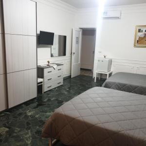 A bed or beds in a room at B&B GANAI - Corso Italia 89 - BARI