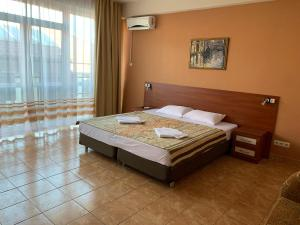 A bed or beds in a room at Relax Guest House