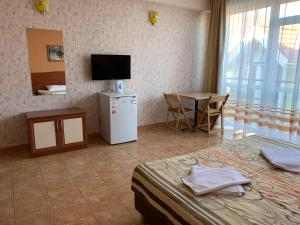 A television and/or entertainment center at Relax Guest House