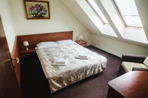 Łóżko lub łóżka w pokoju w obiekcie DW Airen