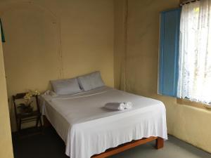 Cama o camas de una habitación en Casarão Dom Bispo