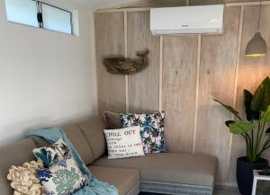 A seating area at CHILL-OUT BEACH HOUSE @ FORSTER