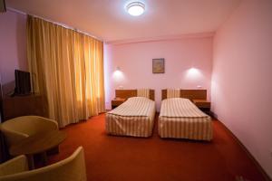 Кровать или кровати в номере Парк Отель Анапа