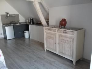 A kitchen or kitchenette at Le Lido