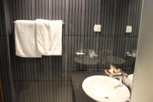 A bathroom at Hotel One Super