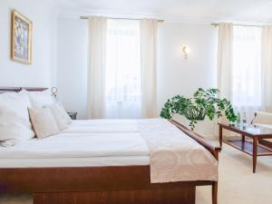 Кровать или кровати в номере Hotel Koloseum