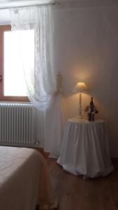 Letto o letti in una camera di Il Castello Di Dante