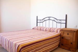 A bed or beds in a room at TAO El Cotillo