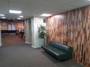 The lobby or reception area at ibis Cardiff Gate - International Business Park