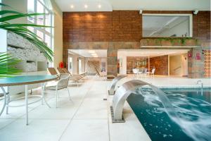 The swimming pool at or near Hotel Laghetto Siena Gramado