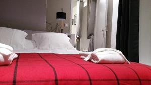 Un ou plusieurs lits dans un hébergement de l'établissement Le Clos St Louis