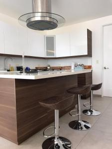 A kitchen or kitchenette at Luxury Apartment Scandi Villas