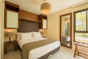 A bed or beds in a room at VG Sun by Vila Galé