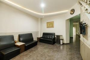 The lobby or reception area at Permata Inn