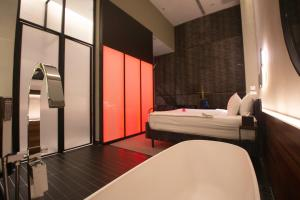 A bed or beds in a room at MOV Hotel Kuala Lumpur