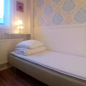 A bed or beds in a room at Varbergs Vandrarhem