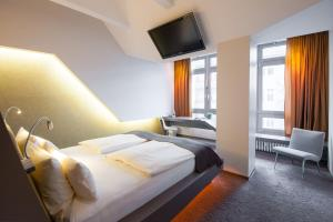 A bed or beds in a room at Aspria Berlin Ku'damm