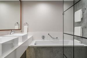A bathroom at Protea Hotel by Marriott Kruger Gate