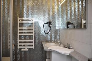 Ein Badezimmer in der Unterkunft Villa Casamia - Übernachtung