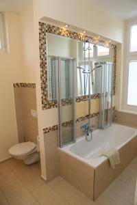 A bathroom at Villa Greve - Deluxe Appartement
