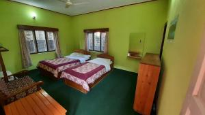 A bed or beds in a room at New Pokhara Lodge