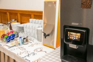 Kuchnia lub aneks kuchenny w obiekcie Hotel Oaza