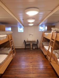 A bunk bed or bunk beds in a room at STF af Chapman & Skeppsholmen