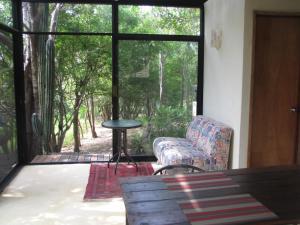 Zona de estar de Centro Sati bungalows