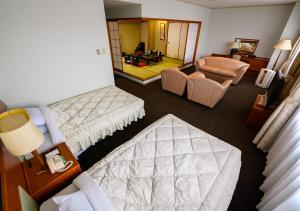 A bed or beds in a room at The Kashihara