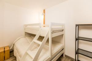 A bunk bed or bunk beds in a room at Le Chardonnet