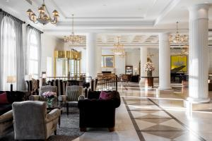 A restaurant or other place to eat at Grand Hotel Kempinski Vilnius