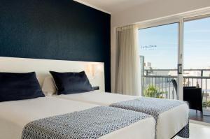Cama o camas de una habitación en Catalonia del Mar - Adults Only